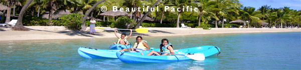 picture of kids kayaking on a family holiday in the south pacific islands