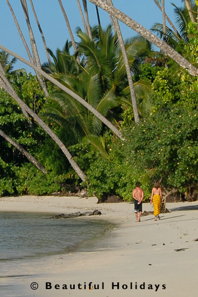 couple enjoy a beach walk on upolu island