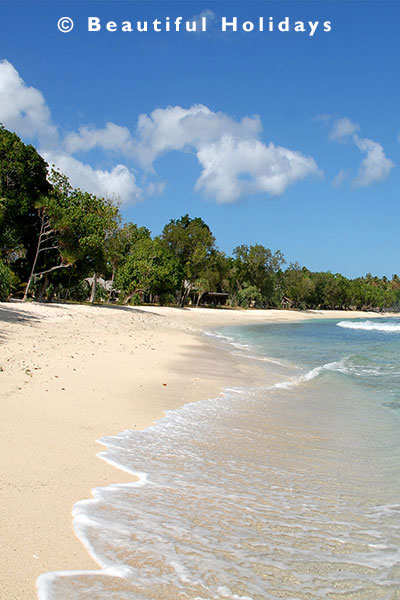 white sandy beach and resort of efate island