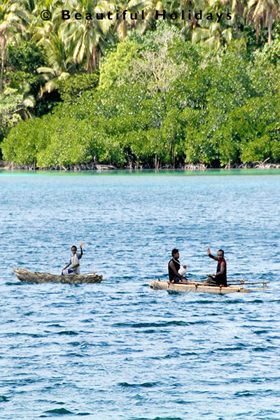 fishing from traditional canoe in erakor lagoon