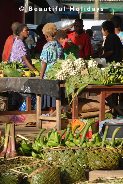 coconut baskets with bananas and root crops at port vila market