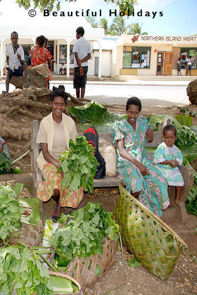 ladies selling root crops at luganville market